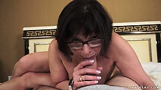 BBW granny in glasses takes a ride on top of a hard meaty shaft