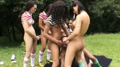 Latina shemales surround a dude out in a field and make him moan