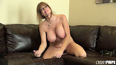 Busty cougar with a hot secretary look masturbates on camera