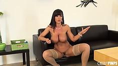 Busty brunette broad in nylon stockings spreads her legs wide open