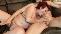 Sexy red-haired GILF gets into some steamy action with a young buck