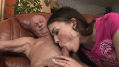 Cute brunette peels off her white panties and has sex with an old man