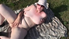Big breasted amateur mom plays with her aching pussy in the outdoors
