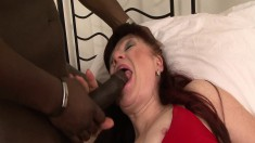 Luscious redhead mature Esmeralda enjoys a big black stick on the bed