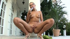 Irresistible girl massages her perky boobs and toys her shaved pussy