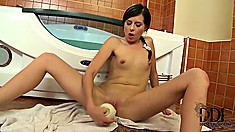 Brunette chick plays in the tub with her bulbous sex toy in her wet snatch