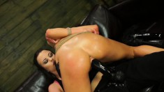 Kinky Sabrina Banks has a strap-on dildo working its magic in her cunt