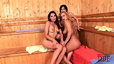 Hot lesbian action in the steamy sauna with a trio of naughty hotties