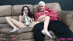 The slender brunette with pretty tits has that sex toy driving her twat to climax