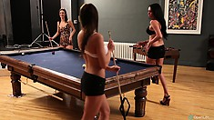 Four sexy brunettes are playing strip billiards, there are no losers