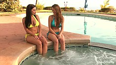 Nice girls dangle their feet in jacuzzi and talk about their mutual feelings