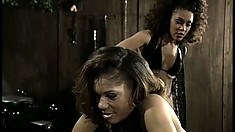 Busty ebony sex slaves get chained up and teased in a dungeon