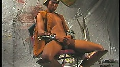 Hot black gladiator caresses his body and strokes his long prick until he cums