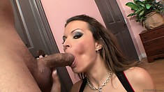 Stacked brunette sticks a big cock in her mouth and sucks with passion