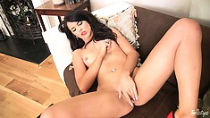 This brunette MILF is eager to get started planting her fingers in her pussy garden