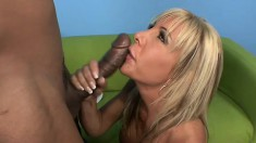 Busty blonde MILF moans while a younger cock pummels her cunt