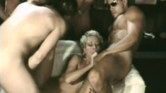 Delightful young babes get into a steamy orgy with three studs