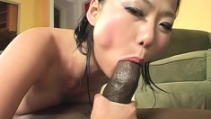 Cute Asian girl surrenders her fiery twat to a black dick and enjoys great pleasure