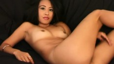Sensual Asian babe Lisa Linn shows off her body and fingers her peach