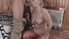 Busty blonde granny in red stockings enjoys hot sex with a younger guy