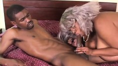 Naughty mature lady with huge breasts feeds her hunger for black cock