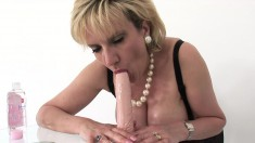 Naughty housewife displays her magnificent curves and pleases herself