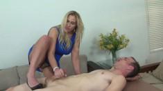 Busty blonde cougar slips out of her blue dress to massage a guy's boner