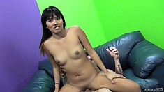 The Asian cutie spreads her legs wide open inviting him to drill her pussy deep