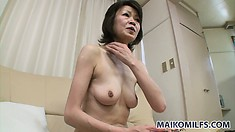 Horny Asian mature with lovely boobs and a tight snatch can't resist a nice cock