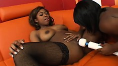 Two flawless black lesbians fully enjoy the pleasure those sex toys have to offer