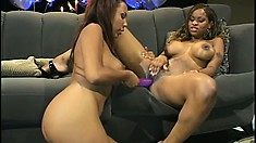 Irresistible ebony lesbians bring out their favorite toys and have some fun